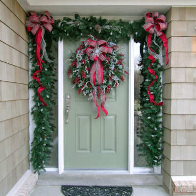 Christmas Door decorated with a Lush Garland and Wreath