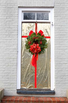 gift wrapped christmas door decorating idea - How To Decorate Your Door For Christmas