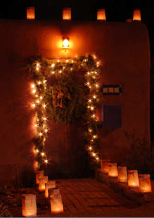 Christmas Doorway lit with Luminarias