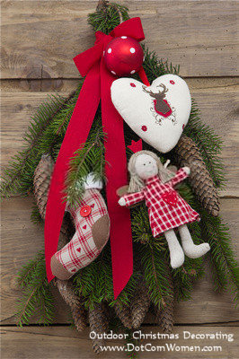 christmas door swag decorated with pinecones and fabric ornaments - Christmas Swag Decorations